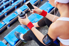Active girl with smartphone Stock Photos