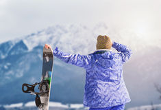Active girl with snowboard on the snow mountain view Royalty Free Stock Images