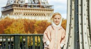 Active girl standing on Pont de Bir-Hakeim bridge in Paris Royalty Free Stock Image