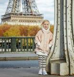 Active girl standing on Pont de Bir-Hakeim bridge in Paris Stock Images