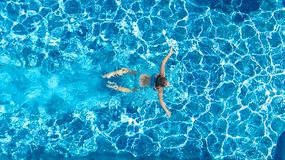 Active girl in swimming pool aerial drone view from above, young woman swims in blue water, tropical vacation, holiday on resort stock images