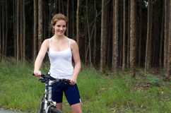 Active girl woman in forest with mountain bike Royalty Free Stock Photos