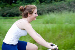 Active girl woman riding mountain bike Royalty Free Stock Images