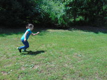 Active Girl. Young girl playing in a field Stock Images