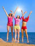 Active girls. On a beach stock photo