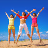 Active girls. On a beach Stock Photos
