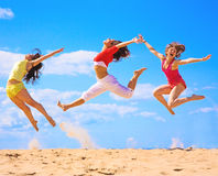 Active girls. On a beach Royalty Free Stock Photos