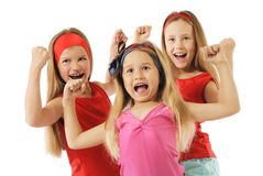 Active girls. Three expressive girls showing their strength stock image