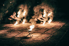 Active girls carries out tricks for fire show at night. Active European girls carries out tricks for fire show at night Stock Photo