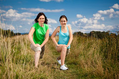Active girls exercising outdoor Royalty Free Stock Image