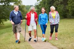 Active group of seniors walking. Active group of seniors together while hiking in nature stock photography