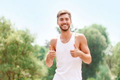 Active guy expressing positivity Royalty Free Stock Images