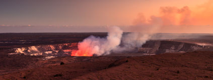 Active Halemaumau Crater At Sunset. Fire glow coming out of the active Halemaumau crater in Volcanoes National Park, Hawaii Big Island Stock Photo