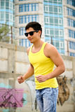 Active handsome man jogging. Young man is out jogging in the city stock image