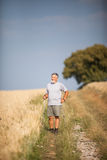 Active handsome senior man nordic walking outdoors Royalty Free Stock Image