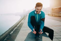 Handsome sportsman training jogging and exercising outdoor Royalty Free Stock Image
