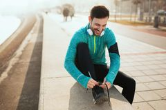 Handsome sportsman training jogging and exercising outdoor. Active handsome sportsman training jogging and exercising outdoor Royalty Free Stock Photography