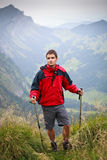 Active handsome young man nordic walking Royalty Free Stock Images