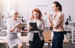 Active happy businesswomen working in the office Royalty Free Stock Image