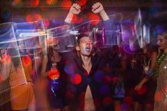 Active happy male on dance floor in motion. Joyful New Year in night club, positive Christmas celebration. Disco party in blurred colors, modern youth life Stock Photo