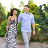 Active and happy young couple walking in the park Royalty Free Stock Photos