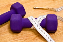 Active healthy life - dumbbells and measure tape Royalty Free Stock Photos