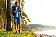 Active healthy man hiking in beautiful forest. Hiking, Forest, Journey royalty free stock photography