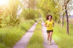 Active healthy young woman enjoying a morning run stock image