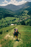 Active hiker with big backpack enjoying the mountain view Stock Image