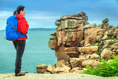 Active hiker woman with backpack enjoying the view, Ploumanach, France Royalty Free Stock Photos