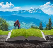 Active hikers family on the pages of book. Active hikers family in a mountains on the pages of an open magical book. Majestic landscape. Travel and education royalty free stock photography
