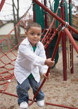 Active hispanic boy. Active preschool hispanic boy playing at school playground Royalty Free Stock Image