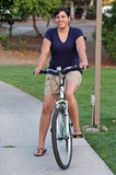 Active hispanic woman on bicycle Royalty Free Stock Photography