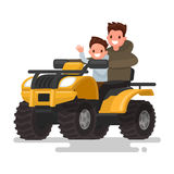 Active holidays. Quad biking. Man and boy are riding a quad bike Stock Image