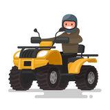Active holidays. Quad biking. Man in a helmet is riding a yellow Stock Image