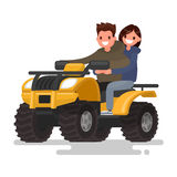 Active holidays. Quad biking. Man and woman are riding a ATV. Ve Stock Photo