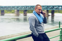 Active jogger talking by cell phone. Stock Images