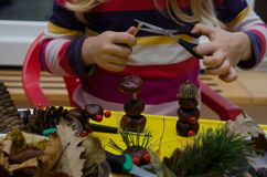 Active child making autumn decoration. Active kid with autumn craftsmaship activities and hobbies Stock Images
