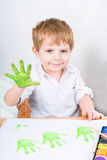Active kid boy having fun with making handpaints Royalty Free Stock Images