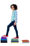 Active kid climbing notebooks ladder Stock Images