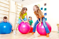 Active kids. Jump on gymnastic balls Stock Photo