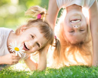 Active kids. Active happy children playing outdoors in spring park royalty free stock image