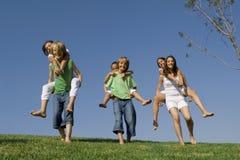 Active kids or children. Happy group active children or kids running piggyback race stock image