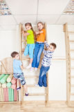 Active kids. Climbing on the wooden wall bars stock image