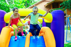 Active kids having fun on playground Royalty Free Stock Images