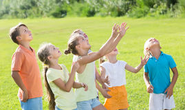 Active kids jumping together in park on summer Royalty Free Stock Photography