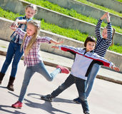 Active kids moving during acting game. At city street Stock Photo