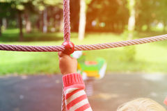 Active kids sport and playtime - hand of child climbing at playground Royalty Free Stock Photo