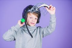 Active leisure and lifestyle. Healthy childhood. Join baseball team. Baseball training concept. Boy in helmet hold. Baseball bat. Sport and hobby. Care about stock photography