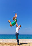 Active life. Couple playing sport on the beach. Sport and active life Royalty Free Stock Photo